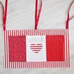 dziecko-organizer 01- pomocnik szyty czerwono-biały dziecięcy pokój kuchnia groszki kropki paseczki łączka 50x30cm-00