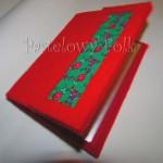 Album na zdjęcia 10x15cm czerwony z zielonym tybetem (S)