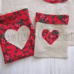 Folkowe lniane woreczki z czerwonymi różami